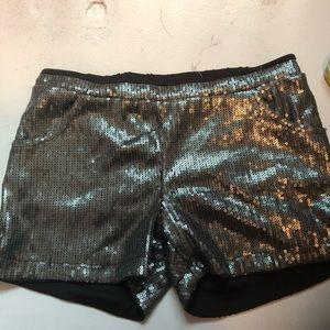 Sequin shorts.